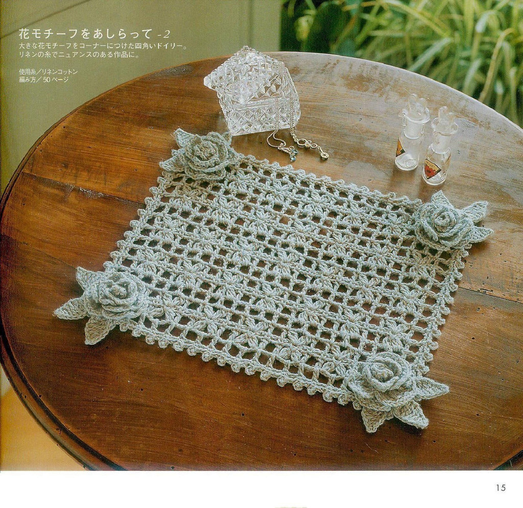 Filet crochet doily with rose flowers