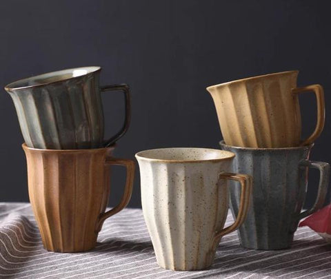 How to make your living room more cosy 10 ideas, go for warmer tones, earthy tones ceramic mugs