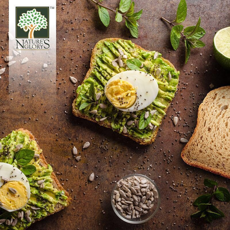 Avocado Spread on bread with Egg, Chia and Pumpkin Seeds