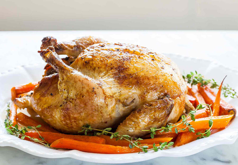 Roast Chicken & Carrots garnished with Herbs