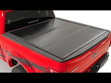 Load image into Gallery viewer, Dodge Low Profile Hard Tri-Fold Tonneau Cover (19-20 Ram 1500 Quad/Mega Cab | 5.5ft; Bed w/o Rambox)