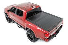 Load image into Gallery viewer, Toyota Low Profile Hard Tri-Fold Tonneau Cover (16-20 Tacoma)