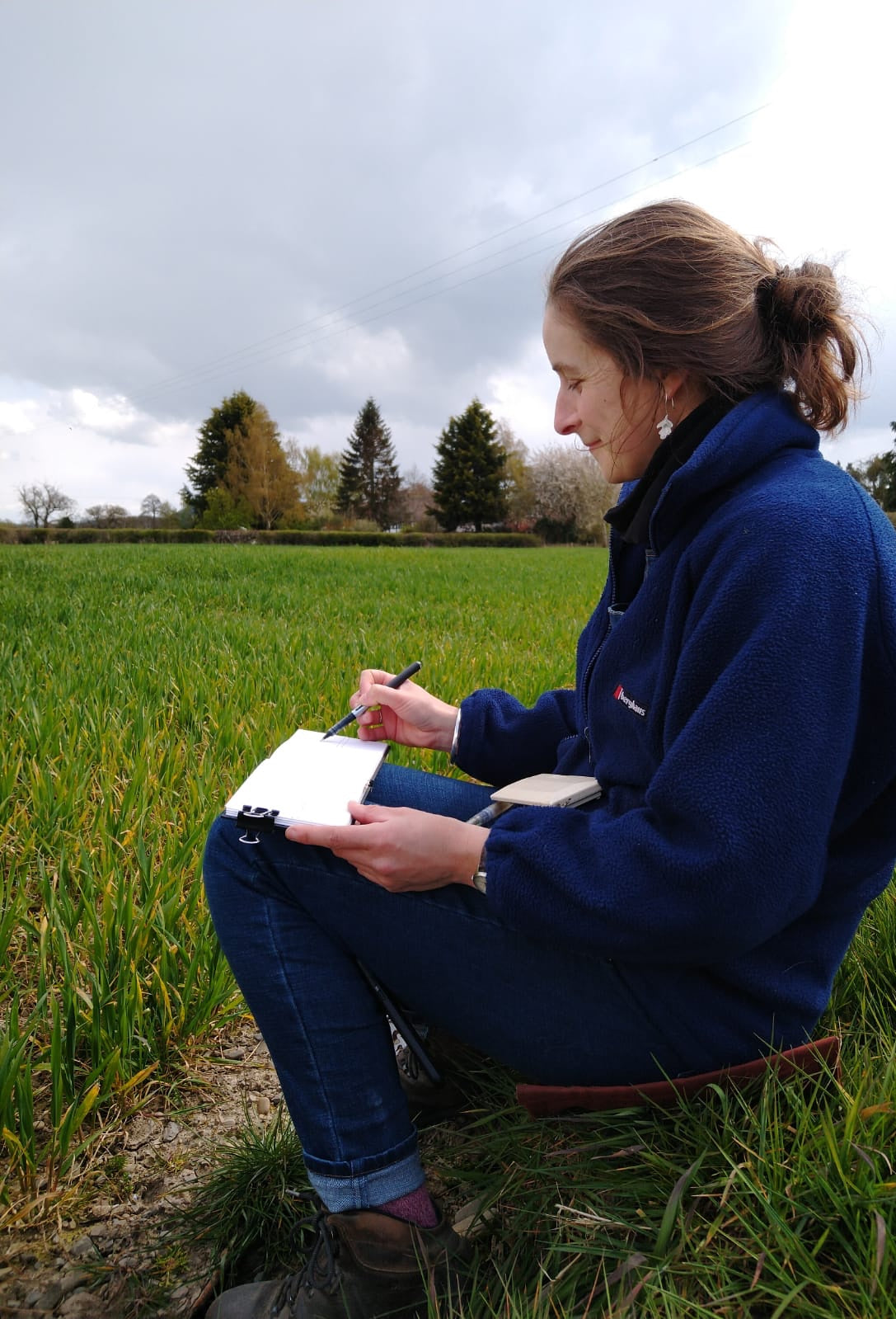 Alice Draws the Line sketching on a field edge