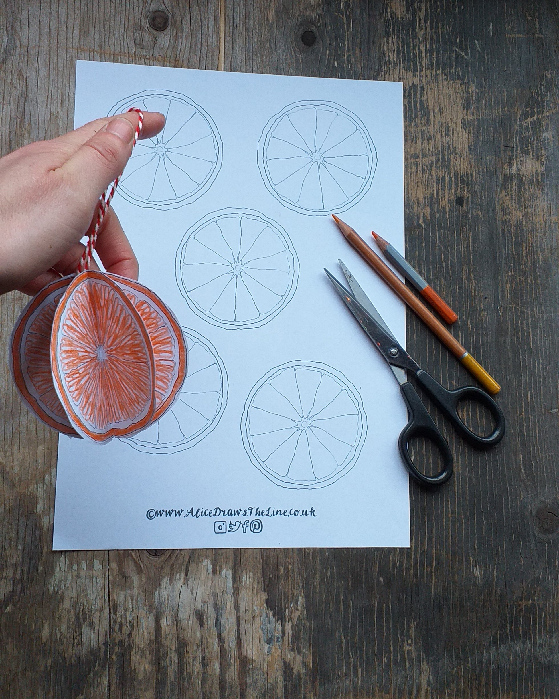 Making a festive paper bauble by Alice Draws the Line, a paper orange to hang on the tree