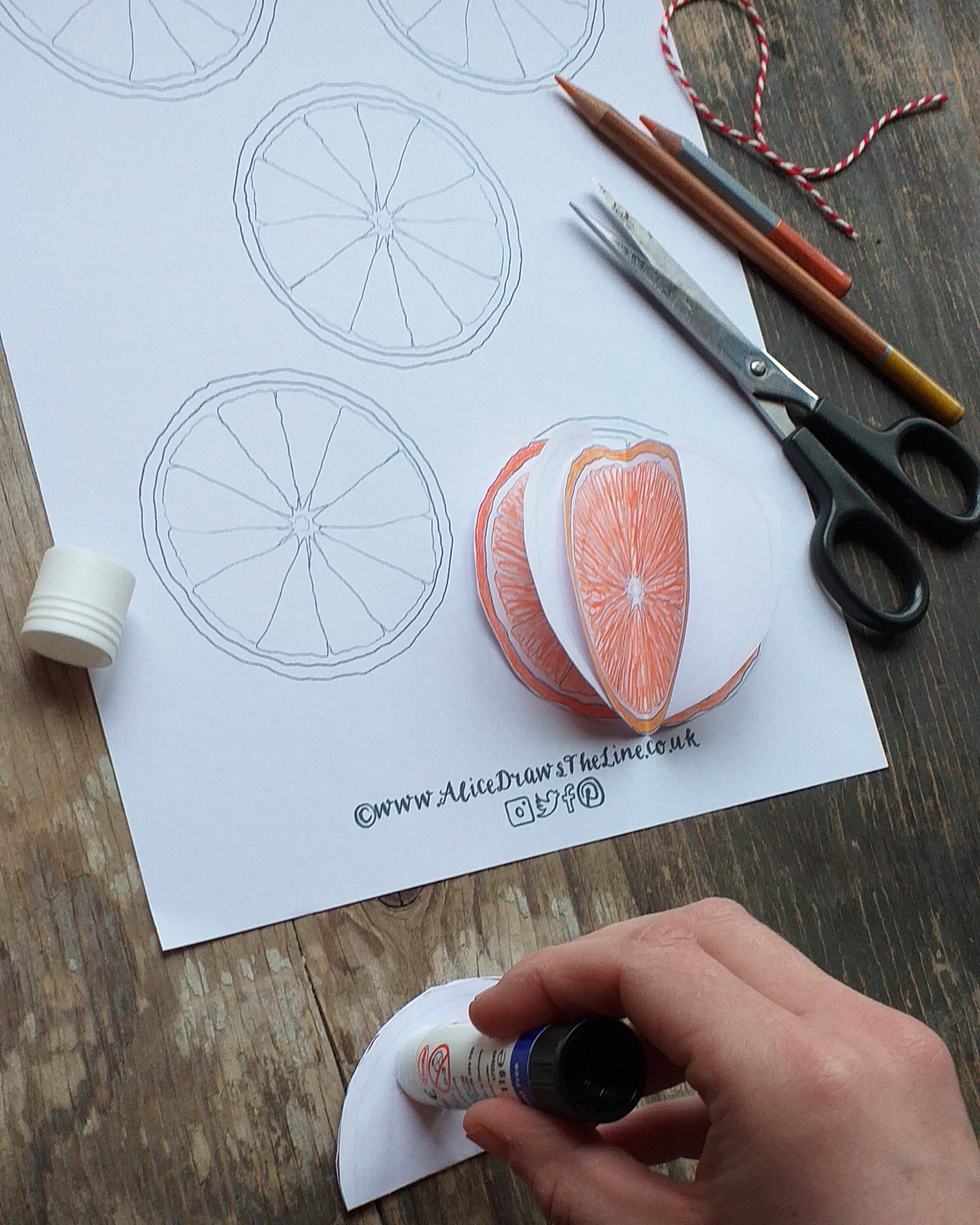 Make a festive bauble at home, a sliced orange bauble decoration by Alice Draws the Line