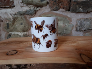 Bee mug by Alice Draws The Line. A china tea or coffee cup covered in bee illustrations