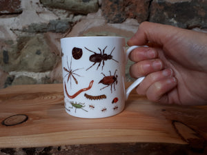 Bug Mug by Alice Draws The Line, a china cup covered in mini-beasts and creepy crawlies