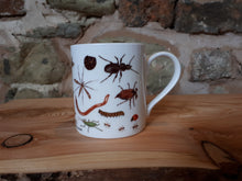 Load image into Gallery viewer, Bug Mug by Alice Draws The Line, a china cup covered in mini-beasts and creepy crawlies