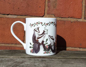 Christmas Badgers China Mug, Badgers with holly, ivy and mistletoe illustrations by Alice Draws The Line