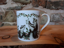 Load image into Gallery viewer, Christmas Badgers China Mug, Badgers with holly, ivy and mistletoe illustrations by Alice Draws The Line