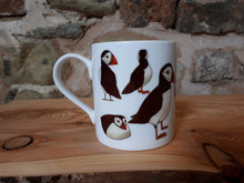 Load image into Gallery viewer, Puffin gift, a puffin mug with lots of cheery puffins to join you in your cup of tea or coffee