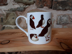 Puffin gift, a puffin mug with lots of cheery puffins to join you in your cup of tea or coffee