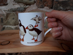 China Puffin Mug by Alice Draws The Line, lots of puffins on a China tea or coffee cup