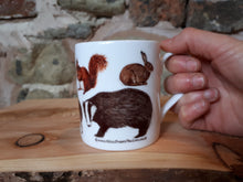 Load image into Gallery viewer, Woodland animals mug by Alice Draws The Line, Woodland fauna species including a hare, fox, badger and hedgehog