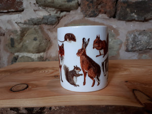 Woodland animals mug featuring a fox, badger, hedgehog, hare and red squirrel