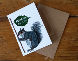 Thinking of You greeting card by Alice Draws The Line featuring a Squirrel holding a leaf sign reading 'thinking of you' (condolence)