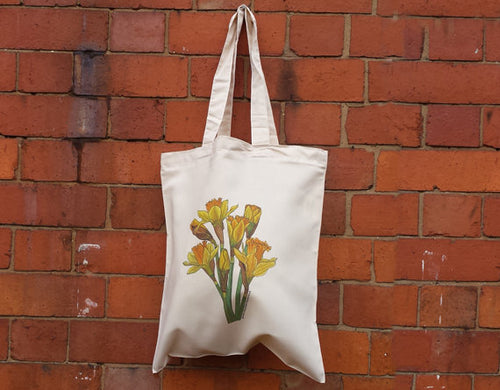 Daffodil bag by Alice Draws The Line, 100% recycled, reusable bag. An illustrated bunch of daffodils printed on a recycled tote bag