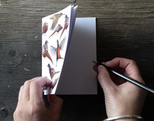 Load image into Gallery viewer, Pheasants Notebook by Alice Draws The Line. Illustrations of pheasants in a range of poses on the cover 36 plain pages A6 recycled notebook