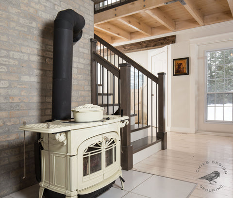 Image of wood burning stove with brick and new staircase