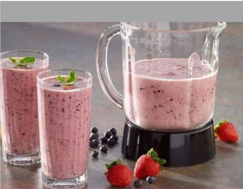 Two glasses of Mixed Berry Smoothie next to blender