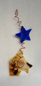 The beautiful coloring of a German shepherd - tans, creams, blacks and greys - are mimicked in this suncatcher, complete with a variegated blue star. Suncatcher hangs 9.5 inches.