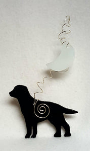 Labrador retrievers are known to be very family friendly and this black one is no exception.  He's standing beneath a misty crescent moon. Suncatcher hangs 8 inches.