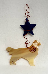 Golden retrievers are known for their happy playful personalities, this one likes to be under a deep blue star. Suncatcher hangs 7 inches.