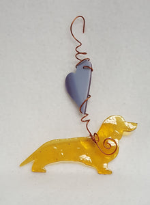 Such a light brown color, this dachshund is almost golden in the light.  A variegated purple heart above him lets him know he's loved. Suncatcher hangs 6 inches.