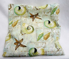 Load image into Gallery viewer, Slip cover is light green and adorned with seashells and starfish.