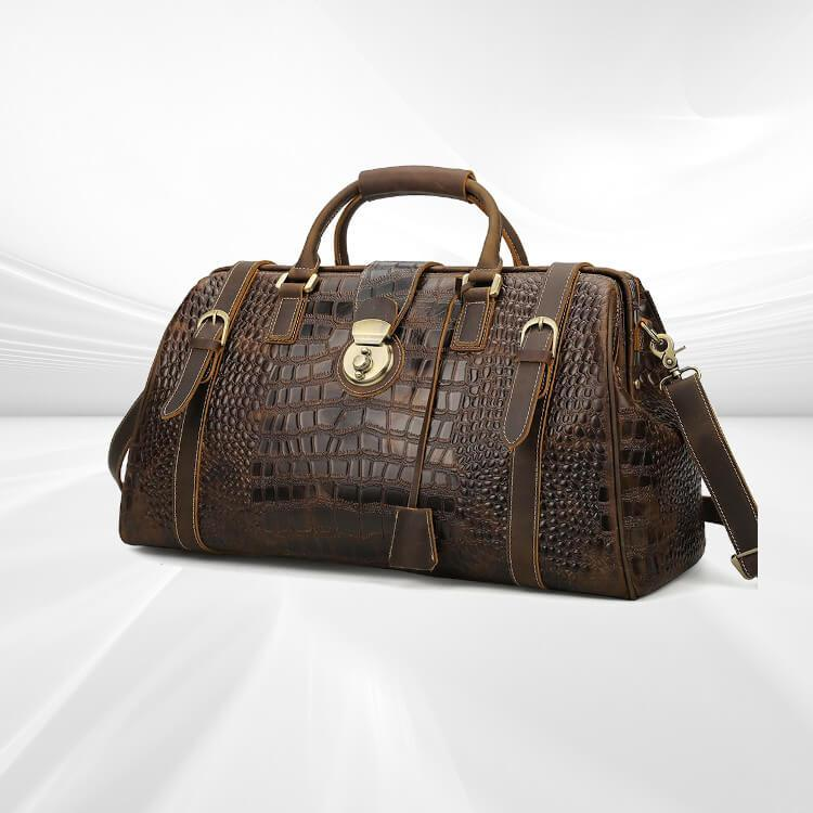 Luxury leather travel duffel bag has unique appearance from embossed crocodile design