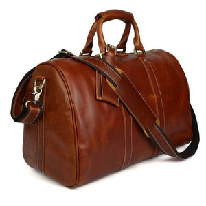 Side angle view of Royalties oil wax top grain leather duffel bag with shoulder strap
