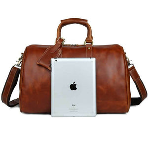 iPad leaning up against the front of oil wax top grain leather duffel bag