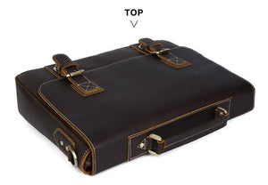 High quality top grain leather durable business briefcase laying on its side depicting the top