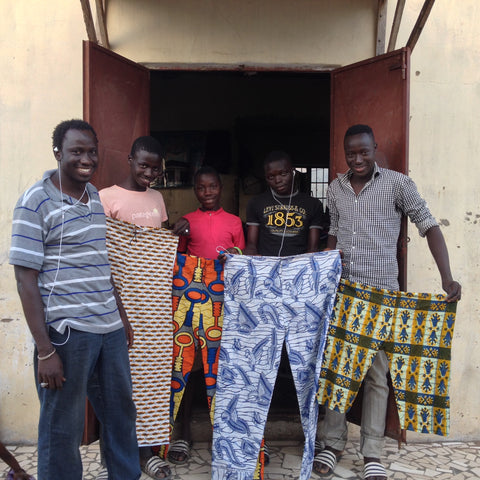 Omar and his tailoring team in Sukuta