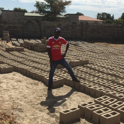 Our Gambia manager building his own compound