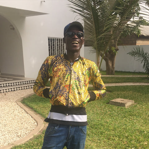 Ethical Clothing, Adama, our Gambian manager wearing one of our bomber jackets