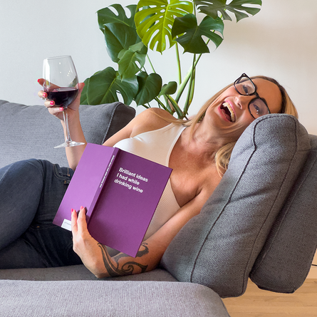 Woman laughing with wine: Funny gift ideas for her