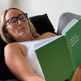 Woman reading notebook with funny cover: The perfect gift for her