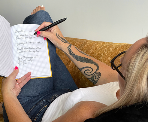 Woman writing in inappropriate notebook