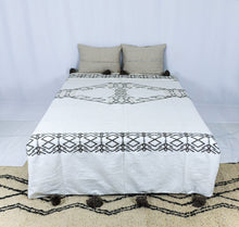 Load image into Gallery viewer, Embroidered Throw: White Throw with Ash Amazigh Patterns and Ash Pom Poms