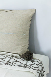 Embroidered Throw: White Throw with Ash Amazigh Patterns and Ash Pom Poms