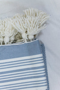 Wool Design Blanket: Pale Blue with White Stripes and White Pom Poms