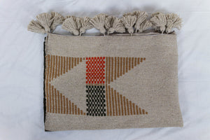 Embroidered Throw: Beige and Orange Geometric Designs with Beige Pom Poms
