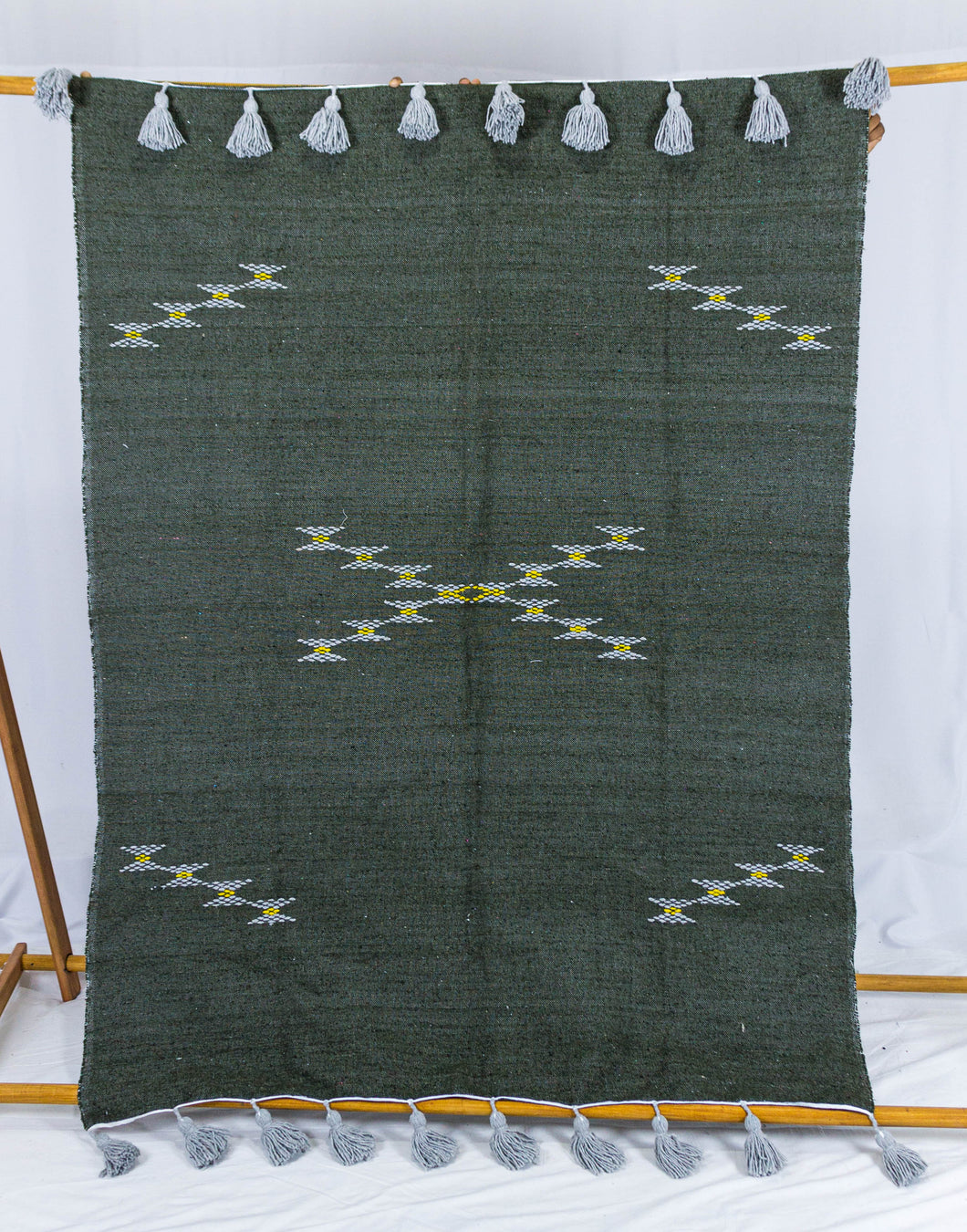 Embroidered Throw: Black Throw with Beige Cross Design and Grey Pom Poms