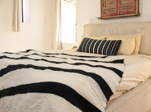 Load image into Gallery viewer, Wool Striped Pom Pom Blanket- White and Black with Black Pom Poms