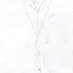 Shira Melody Holland Bib Necklace in Gold