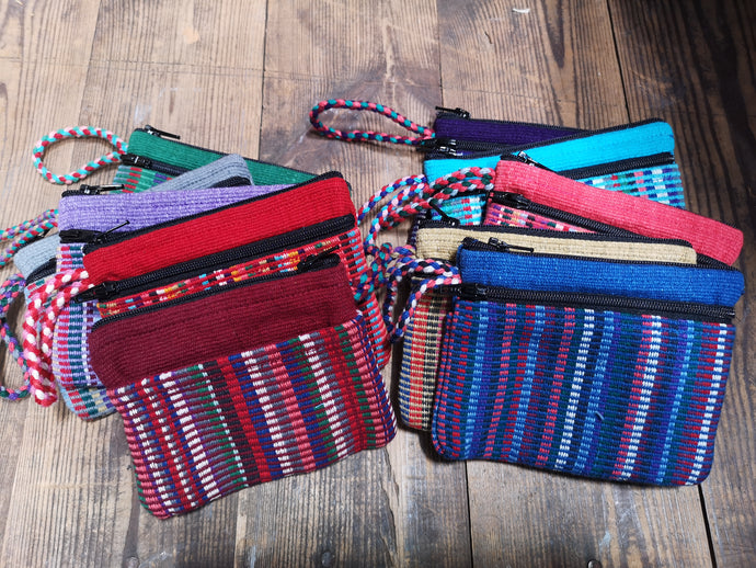Selection of Unisex Cotton Purses, with 3 pockets two with zip closure.  Suitable for Cash and Cards.  Handmade in Nepal by a fair trade cooperative.  Matching Bags available, makes the perfect gift for someone special.