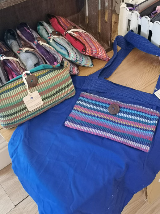 Cool Trade Winds - Cotton Bag For Life.  Rolls up into a pocket to keep it neat and tidy.  When in use the pocket can be used to hold a shopping list, keys or purse.  Handmade in Nepal by a fair trade cooperative.