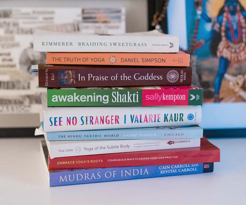 A stack of educational yoga books