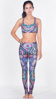 front view of model wearing purple latin beads inspired sports bra with matching leggings